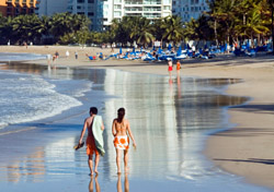 Couple walking on the sand in San Juan, Puerto Rico (Photo: TexPhoto, iStockphoto.com)