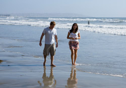 San Diego Couple Walking on Beach (iStockPhoto: Michael DeLeon)