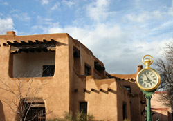 New Mexico - Santa Fe: Old Clock With Adobe Buildings (Photo: Thinkstock/iStockphoto)