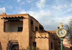 New Mexico - Santa Fe: Old Clock With Adobe Buildings (Photo: Thinkstock/iStockphoto)
