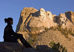 Woman looking at Mt. Rushmore (Photo: South Dakota Tourism)