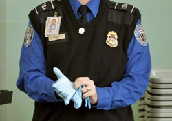 Security: TSA Agent Dons Rubber Gloves