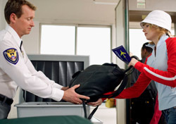Security: TSA Handing Bag to Female Traveler (Photo: Thinkstock/Creatas)