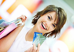 Shopping: Woman with Credit Cards and Shopping Bags (Photo: Thinkstock/Hemera)