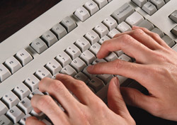Two hands on keyboard (Photo: PhotoDisc)