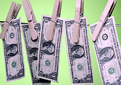 Dollar bills on a line (Photo: Index Open)
