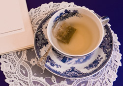 Tea and poetry book (Photo: iStockPhoto/alphavisions)