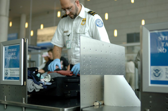 TSA Agent Searching Bag (Photo: Carolina K. Smith, M.D. /Shutterstock.com)