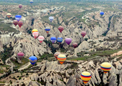 "Turkey: Hot Air Balloons - A majestic balloon ride in central Turkey can take you over the eroded ""badlands"" of Cappadocia. (Photo: Rick Steves)"
