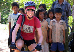 Megan Hassett with villagers in Vietnam (Photo: Intrepid Travel)