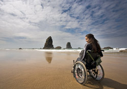 Woman in a wheelchair at the beach (Photo: iStockphoto./Jay and Varina Patel)