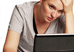 Woman: Anxious, Looking at Laptop (Photo: Shutterstock/O Driscoll Imaging)