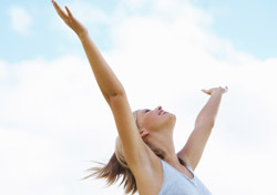 Woman: Arms up Toward Clouds (Photo: Thinkstock/iStockphoto)