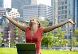 Woman: At Park with Raised Arms (Photo: Thinkstock/Jupiterimages)