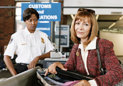 Woman: Opening Bag While at Security (Photo: Thinkstock/Digital Vision)