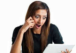 Woman: Shocked, Looking at iPad (Photo: Thinkstock/iStockphoto)