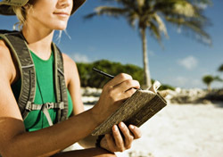 Woman: Writing in Journal (Photo: Thinkstock/Jupiterimages)