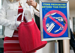 Air: Woman With Purse by Airport Security Sign