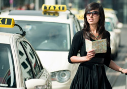 Woman standing at a Taxi Stand (Photo: iStockphoto/Willie B. Thomas)