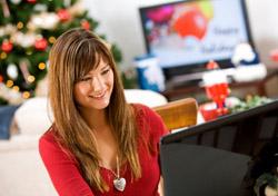 Woman Booking Holiday Travel On Computer (Photo: iStockphoto/Sean Locke)