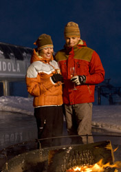 Jackson Hole Resort - Couple standing by fire (Photo: Jackson Hole Resort)